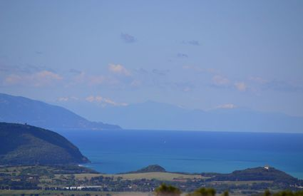 View from Campiglia Marittima towards the gulf of Baratti, Elba and Corsica, morning, spring.