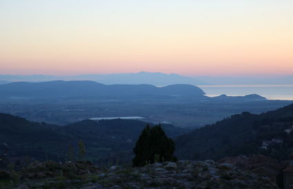 View from Campiglia Marittima towards the gulf of Baratti, Elba and Corsica, sunset, autumn.